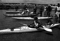 [Photo: Eusden and students in sea kayaks]