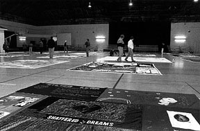 [Photo: panels of the AIDS quilt in the Cage]
